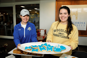 Twin students Lara May, left, and Karley May of Milford, Pa., display the special cookies for the groundbreaking ceremony.